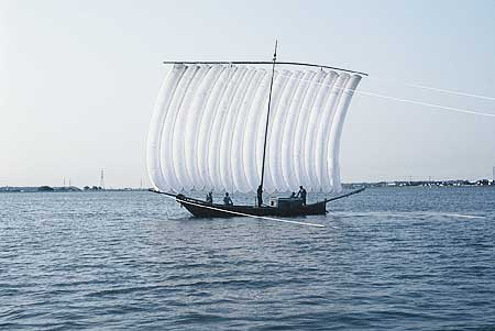The fishing ship with a white sail